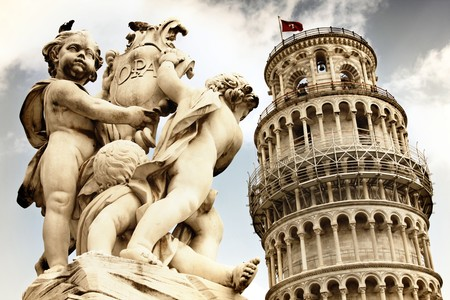 Leaning tower and statue angel in Pisa, Tuscany, Italy  photo