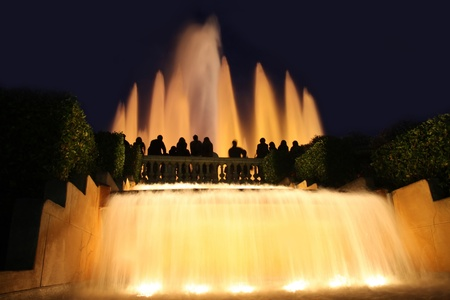 details group tourists photographing fountain in city Barcelona, Spain photo