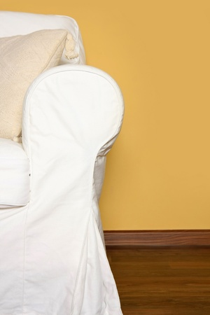 Details shot of a white couch near yellow wall Stock Photo - 12383261
