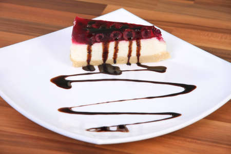 Piece of cake on the plate with chocolate sauce photo