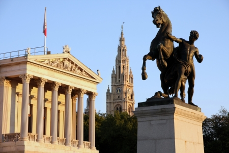 rathaus: The Austrian Parliament, Statue of man and the horse and Rathaus in Vienna, Austria