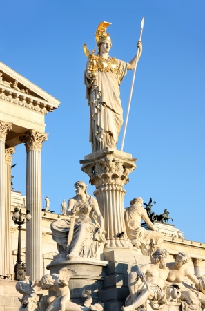 The Austrian Parliament and Athena Fountain in Vienna, Austria photo