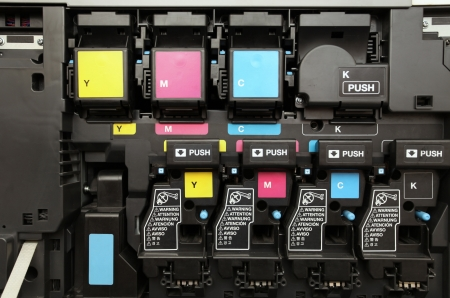 object printing: close-up shot of a CMYK ink cartridges for laser copier machine  Stock Photo