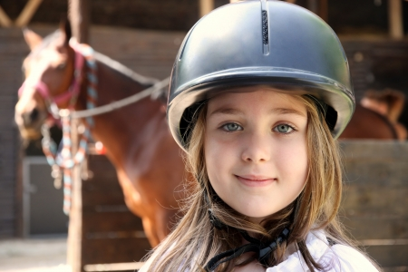 pretty pony: Portrait of little girl and brown Horse