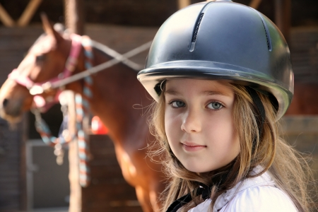 pony girl: Portrait of little girl and brown Horse