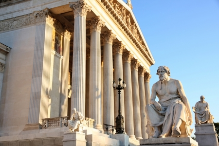 The Austrian Parliament with statue philosopher Thucydides in Vienna, Austria Stock Photo