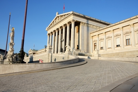 The Austrian Parliament and Athena Fountain in Vienna,\ Austria