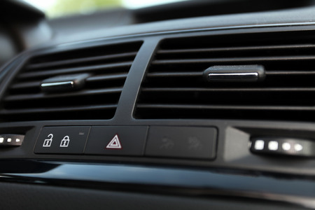 Details of Car emergency button and air conditioning  car ventilation system  in modern car photo