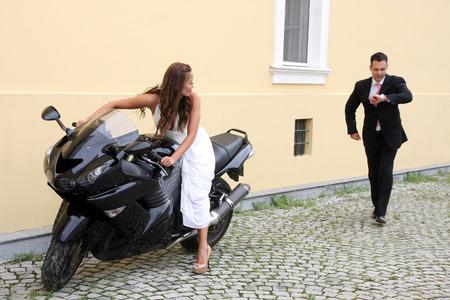 Wedding on the nature, young wedding couple with motorbike photo