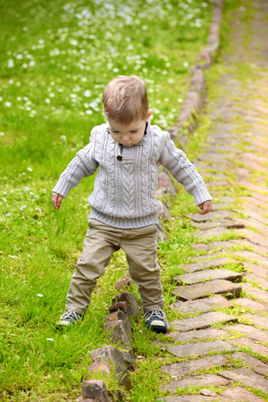 baby boy playing in park photo