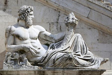 tevere: Piazza del Campidoglio - Statue del Tevere in Rome, Italy Editorial