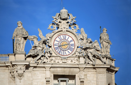 maderno: Madernos facade with the clock between two statues, St. Peters Basilica. Vatican City, Rome, Italy