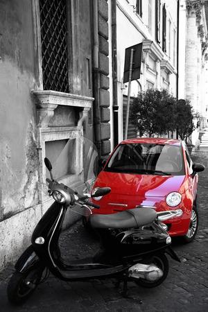 italia: Red tiny car at the city street, Rome, Italia (blackwhite)