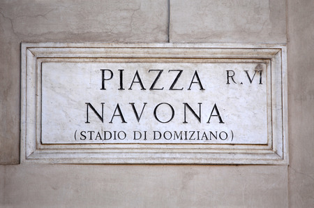Piazza Navona sign on building wall in Rome, Italy