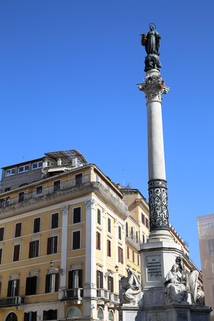 Mother Mary: Column of the Immaculate Conception monument with Virgin Mary on top at Piazza di Spagna in Rome, Italy