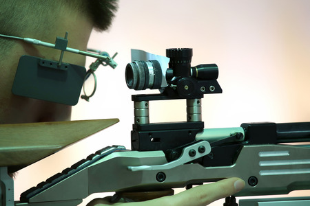 sniper rifle: young man aiming a pneumatic air rifle
