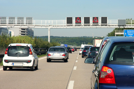 cars in traffic jam on highway, in Germany Stock Photo