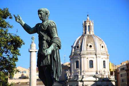 spqr: Statue S.P.Q.R. IMP.CAESARI.NERVAE.F.TRAIANO OPTIMO PRINCIPI1 and Santa Maria di Loreto in Rome, Italy
