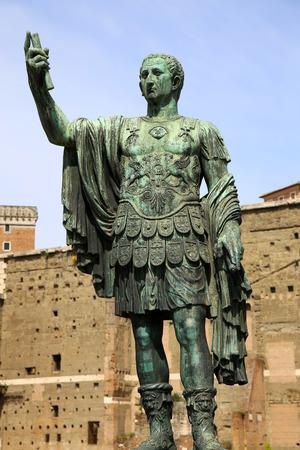 spqr: Statue S.P.Q.R. IMP.CAESARI NERVAE Augustus on street Via dei Fori Imperiali, Rome, Italy Stock Photo