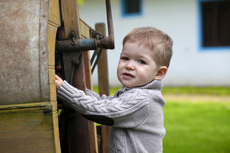 2 years old: 2 years old curious Baby boy managing with old agricultural Machinery