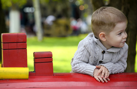 2 years old: 2 years old Baby boy on playground in spring outdoor park Stock Photo