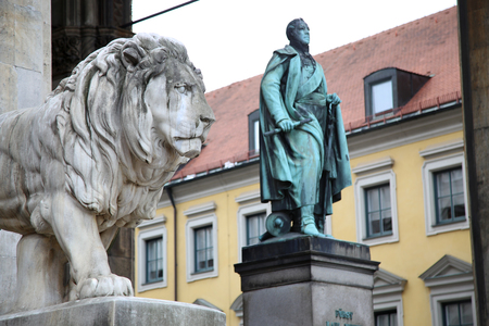 residenz: details of a stone lion sculpture and  Statue of Karl Wrede at the Odeonsplatz - Feldherrnhalle in Munich Germany