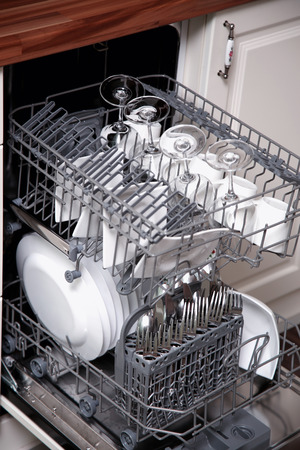 dishwasher: Open dishwasher with clean utensils Stock Photo