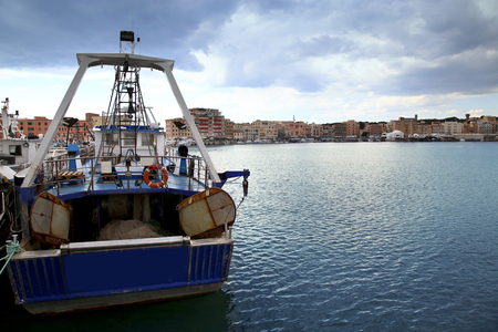 barca da pesca: Panoramic view of port Anzio, with the fishing boats and fishing nets, Italia
