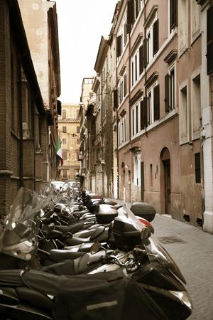 italia: Scooters at the old street, Rome, Italia Stock Photo