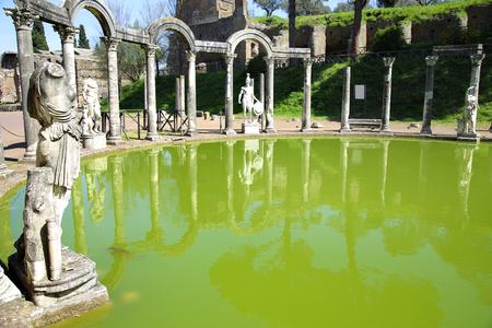 the architecture is ancient: Ancient ruins of Villa Adriana ( The Hadrians Villa ), Canopo, Tivoli, Italy Stock Photo