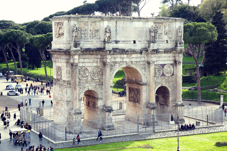 ROME; ITALY - APRIL 08: Tourists at the Arch of Constantine in Rome; Italy, view from Colloseum. Rome is the capital of Italy and region of Lazio. Italy on April 08; 2015.