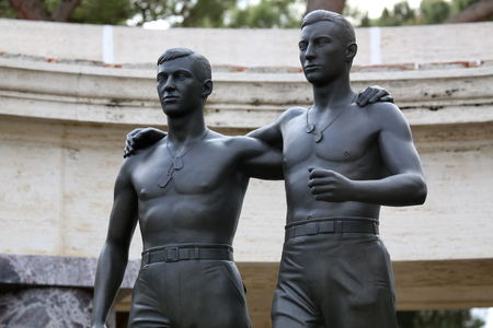 military cemetery: NETTUNO - April 06: Bronze statue of two brothers in arms of the American Military Cemetery of Nettuno in Italy, April 06, 2015 in Nettuno, Italy. Editorial