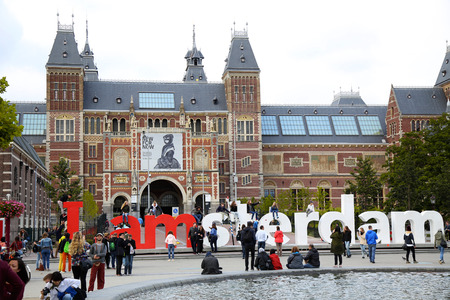 rembrandt: AMSTERDAM, THE NETHERLANDS - AUGUST 18, 2015: View on Rijksmuseum (National state museum) with words, popular touristic destination in Amsterdam, Netherlands. Amsterdam is capital of the Netherlands on August 18, 2015.