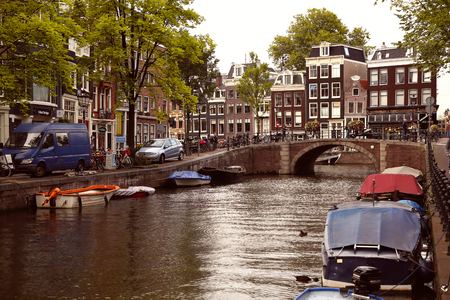prinsengracht: AMSTERDAM, THE NETHERLANDS - AUGUST 18, 2015: View on Prinsengracht from Spiegelgracht. Street life, Canal, bicycle and boat in Amsterdam. Amsterdam is capital of the Netherlands on August 18, 2015. Editorial