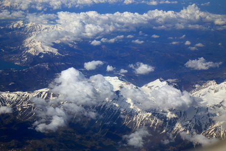 window view: Aerial view snow mountain from window of airplane