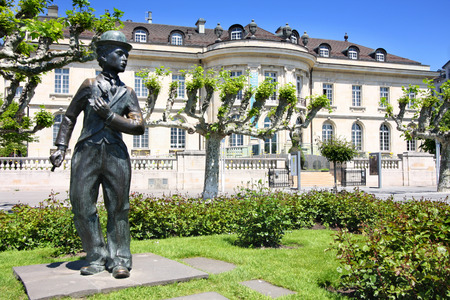 VEVEY, SWITZERLAND - 24 MAY: Bronze statue of comedian actor Charlie Chaplin on the promenade in Vevey (Vaud), Switzerland on May 24,2010.