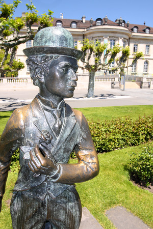 screenwriter: VEVEY, SWITZERLAND - 24 MAY: Bronze statue of comedian actor Charlie Chaplin on the promenade in Vevey (Vaud), Switzerland on May 24,2010.
