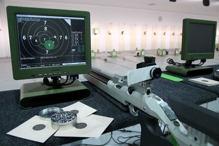 airgun: air rifle and 10m target monitor on sports competition