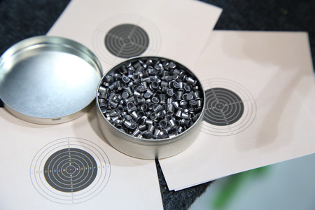 pellet gun: aluminum can of lead pellets for air rifle and target