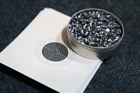 aluminum can of lead pellets for air rifle and target