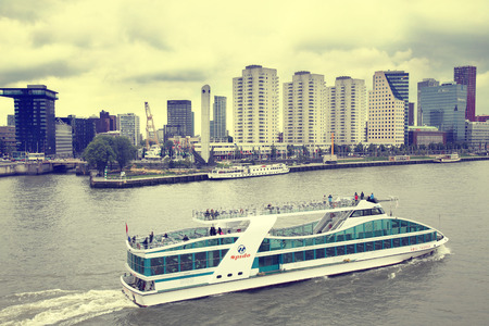 maas: ROTTERDAM, THE NETHERLANDS - 18 AUGUST: View from Erasmus bridge on skyline of Rotterdam with a cruise boat, river Maas in Rotterdam, Netherlands on August 18,2015. Editorial