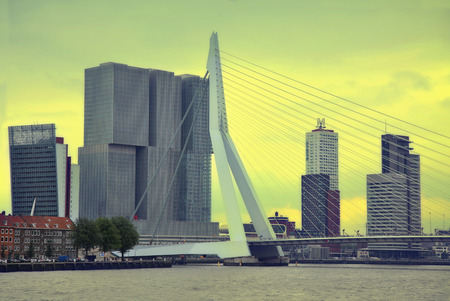 ROTTERDAM, THE NETHERLANDS - 18 AUGUST: Rotterdam is a city modern architecture, view on Erasmus Bridge and skyline of Rotterdam, river Maas in Rotterdam, Netherlands on August 18,2015.