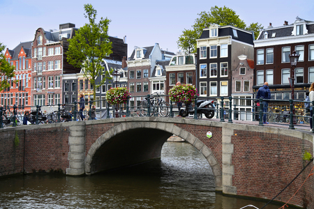 prinsengracht: AMSTERDAM, THE NETHERLANDS - AUGUST 18, 2015: View on Prinsengracht from Spiegelgracht. Street life, Canal, pedestrians and bicycle in Amsterdam. Amsterdam is capital of the Netherlands on August 18, 2015. Editorial