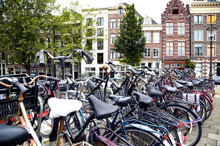 bike parking: AMSTERDAM; THE NETHERLANDS - AUGUST 16; 2015: Lots of bicycles parked at the bike parking in Amsterdam. Amsterdam is capital of the Netherlands on August 16; 2015.