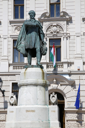 pecs: Statue of Lajos Kossuth and governmental building in Pecs, Hungary.
