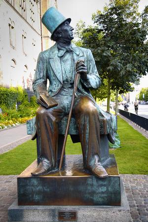 hans: Monument of Hans Christian Andersen standing next to Radhus, Copenhagen city hall, Copenhagen, Denmark Editorial