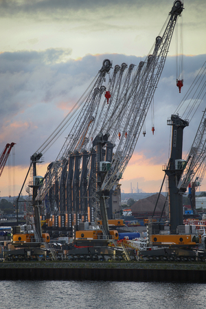 rostock: ROSTOCK, GERMANY - AUGUST 14, 2016: Container terminal and cranes in the port of Warnemunde. Rostock is largest Baltic port(photographed early in the morning)in Rostock, Germany on August 14, 2016. Editorial