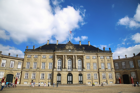 frederik: Copenhagen, Denmark – August  15, 2016: Amalienborg Square, with tourist, its home of the Danish Royal family in Copenhagen, Denmark Editorial