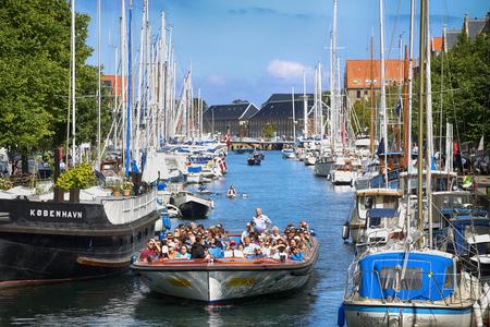 beetwen: Copenhagen, Denmark – August 15, 2016: View on canal with tourist boat, beetwen Overgaden Oven Vandet street and Overgaden Neden Vandet street from bridge Sankt Anne Gade in Copenhagen, Denmark