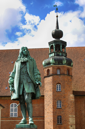 The statue of Chancellor Peder Griffenfeld and a tower in Copenhagen, Denmark
